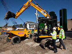© Licensed to London News Pictures. 01/08/2013. London, UK. Bori Johnson, the Mayor of London, is seen using an earthmover as he officially launches the start of regeneration work in Elephant and Castle, London, today (01/08/2013). Work in the area will see over 280 homes, retail and business space as well as a community leisure centra. Photo credit: Matt Cetti-Roberts/LNP