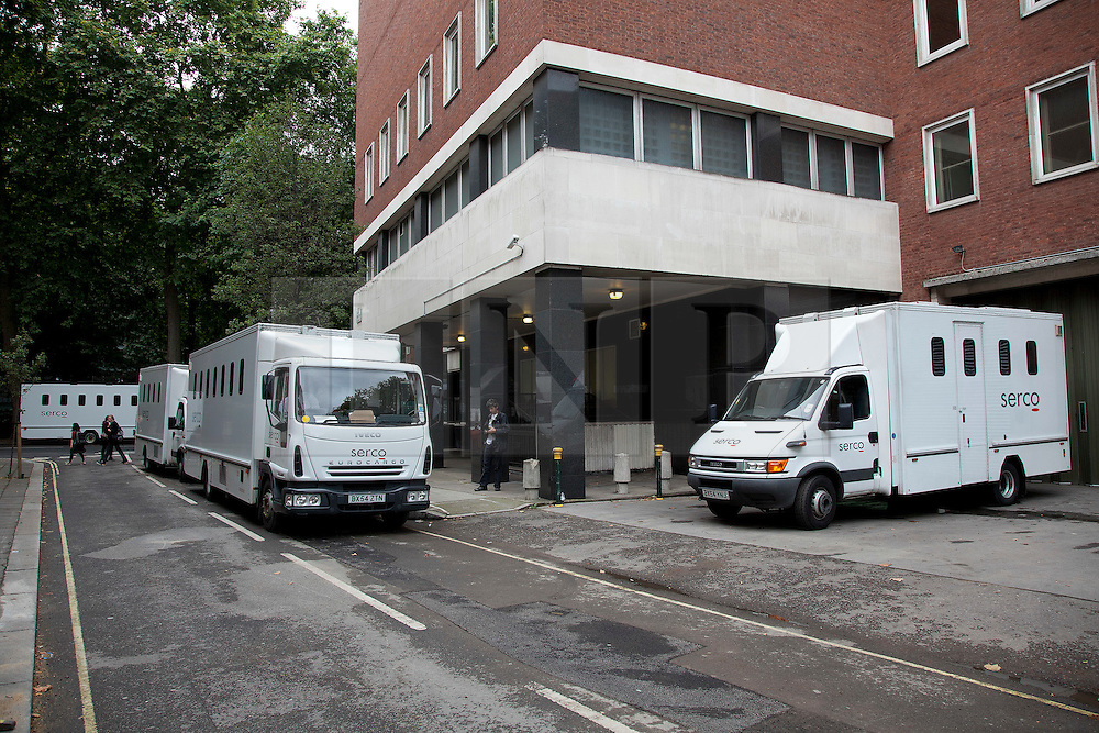 © Licensed to London News Pictures. 11/08/2011. LONDON, UK. As London courts work late to process those arrested during the recent London riots prisoner transport vans are seen outside Westminster Magistrates court. Photo credit: Matt Cetti-Roberts/LNP