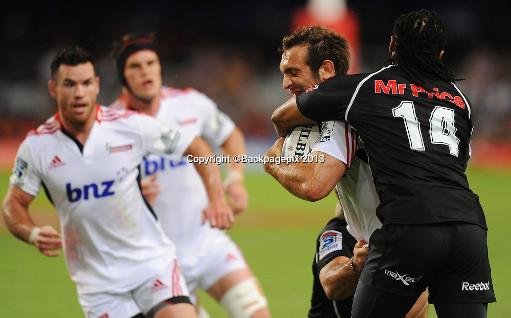 Andy Ellis of the Crusaders battles Odwa Ndungane of The Sharks during Rugby in the 2013 Super Rugby match between The Sharks and Crusaders on the 5th of April 2013 at the KINGS PARK Stadium in Durban<br />  <br /> &copy;Sabelo Mngoma/BackpagePix
