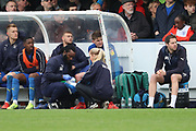 AFC Wimbledon defender Steve Seddon (15) injured during the EFL Sky Bet League 1 match between AFC Wimbledon and Accrington Stanley at the Cherry Red Records Stadium, Kingston, England on 6 April 2019.