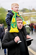 Young Norwich fan on an adults shoulders outside the stadium before the EFL Sky Bet Championship match between Norwich City and Blackburn Rovers at Carrow Road, Norwich, England on 27 April 2019.