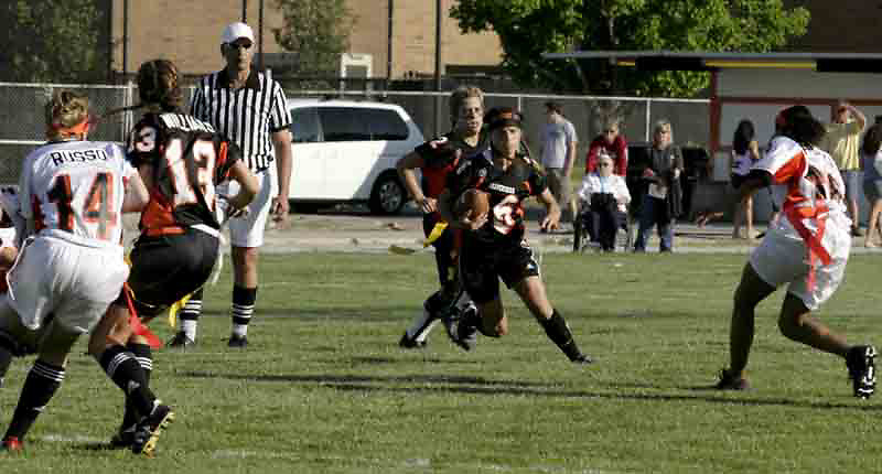 Senior Kelly Blumenschein (16) runs for the hole during the 3rd Annual Powderpuff Challenge, the junior girls (class of 2008) against the senior girls (class of 2007.)