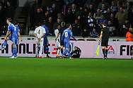 Chelsea's Eden Hazard (out of pic ) is sent off after incident with Swansea  city ballboy (on ground). Capital one cup semi final, 2nd leg, Swansea city v Chelsea at the Liberty Stadium in Swansea on Wednesday 23rd Jan 2013. pic by Andrew Orchard, Andrew Orchard sports photography,