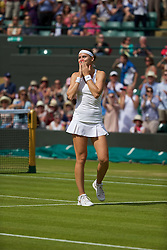 LONDON, ENGLAND - Tuesday, July 1, 2014: Lucie Safarova (CZE) celebrates after winning the Ladies' Singles Quarter-Final match 6-3, 6-1 on day eight of the Wimbledon Lawn Tennis Championships at the All England Lawn Tennis and Croquet Club. (Pic by David Rawcliffe/Propaganda)
