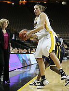 08 February 2007: Iowa forward Wendy Ausdemore (32) tries to control the ball near the sideline in Iowa's 66-49 win over Michigan at Carver-Hawkeye Arena in Iowa City, Iowa on February 8, 2007.