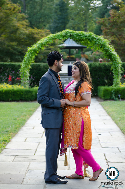 Lovely Indian couple enjoys a photography session in a public garden. <br /> Photographs by Maria Rock Photography of Miami, Florida.