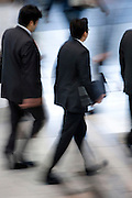 businessmen walking together Japan Tokyo