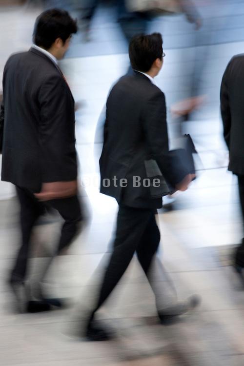 businessmen walking together Japan Tokyo