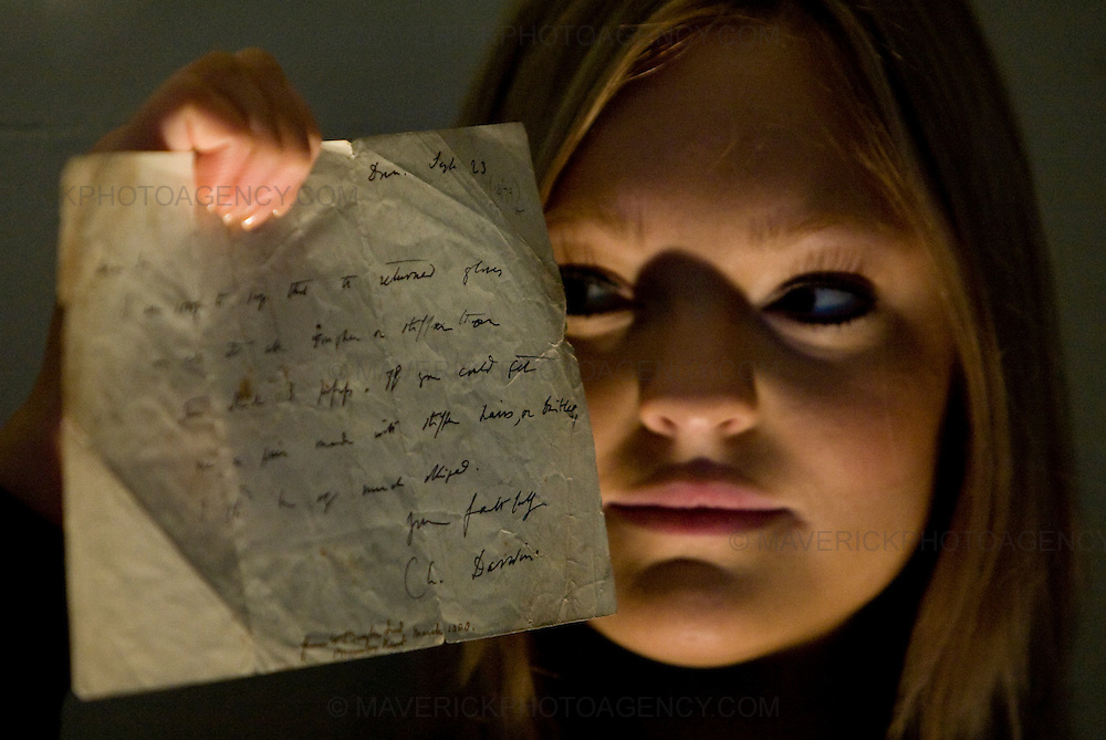 ..Gallery Assistant Heidi Squirell holds a signed letter from Charles Darwin dated 1879 valued at £600...29/1/2009.Picture Michael Hughes/Maverick