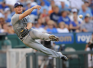 ESPN -- Tampa Bay Rays third basemen Brooks Conrad (36) makes a leaping throw to first base against the Kansas City Royals during the third inning at Kauffman Stadium.