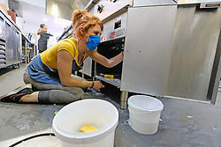 JOHANNESBURG SOUTH AFRICA - MAY 01 A Delta Cafe staff member deep cleans kitchen space, prior to preparing food for delivery on May 01, 2020 in Johannesburg South Africa. South Africa moved down to Level 4 of the national lockdown with relaxed restrictions as part of a risk adjusted 5 stage phasing of lockdown measures. This includes allowing of certain restaurants to reopen for trade and prepare hot food as delivered takeaway only. (Photo by Gallo Images/ Dino Lloyd)