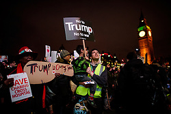 © Licensed to London News Pictures. 20/02/2017. London, UK. A protest held outside the Houses of Parliament in London on the day that MPs in the House of Commons debate President Donald Trump's planned state visit to the UK.Over a million people signed a petition calling for the state visit to be cancelled.  Photo credit: Ben Cawthra/LNP