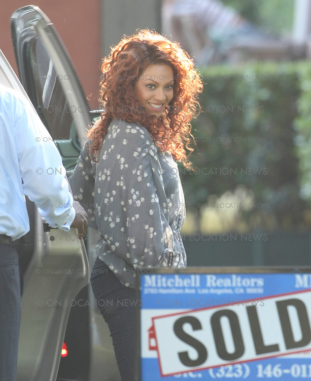 LOS ANGELES, CALIFORNIA - MONDAY 23rd JUNE 2008 EXCLUSIVE: Beyonce Knowles and Idris Elba film scenes for  'Obsessed'. Beyonce and Idris play husband and wife. In this scene they arrive with their child to a new home they just purchased. Photograph: On Location News. Sales: Eric Ford 1/818-613-3955 info@OnLocationNews.com