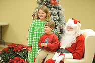 Children visit with Santa Claus during Family Crisis Services' Milk and Cookies with Santa in Oxford, Miss. on Thursday, December 5, 2013. Addy Photography provided photography of the event.
