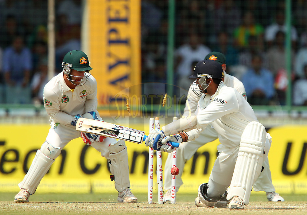 Murali Vijay of India is bowled by Glenn Maxwell of Australia during day 3 of the 4th Test Match between India and Australia held at the Feroz Shah Kotla stadium in Delhi on the 24th March 2013..Photo by Ron Gaunt/BCCI/SPORTZPICS ..Use of this image is subject to the terms and conditions as outlined by the BCCI. These terms can be found by following this link:..http://www.sportzpics.co.za/image/I0000SoRagM2cIEc