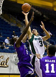 December 29, 2009; Berkeley, CA, USA;  Utah Valley Wolverines guard Shawn Deadwiler (3) shoots past Furman Paladins forward Neil Duval (2) during the second half at the Haas Pavilion.  Furman defeated Utah Valley 77-69.