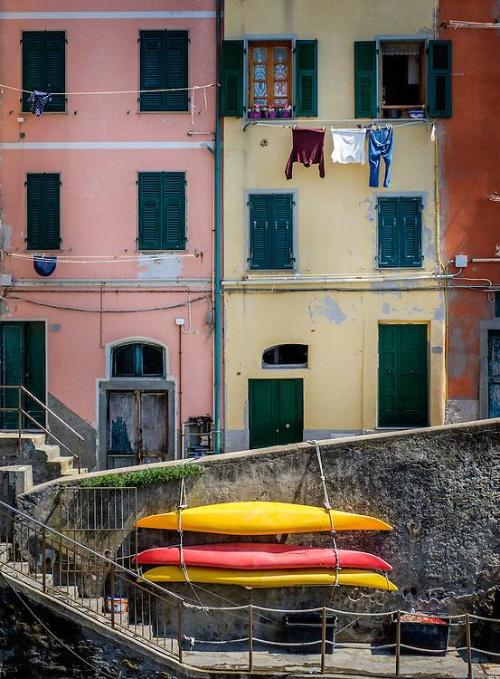 RIOMAGGIORE, ITALY - CIRCA MAY 2015:  Colorful walls and windows in the village of Riomaggiore in Cinque Terre, Italy.