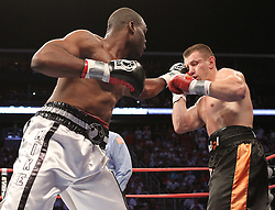 Aug 21, 2010; Newark, NJ, USA; Tomasz Adamek and Michael Grant trade punches during their 12 round bout at the Prudential Center.  Adamek won via 12 round unanimous decision.