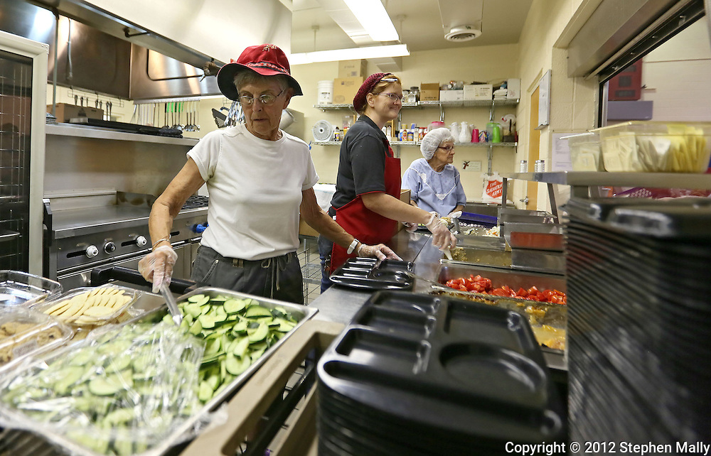 Volunteer Jill Snodgrass (from left), Kitchen Manager Candie Edmonds, and Volunteer Shirley Hendrickson, all of Cedar Rapids, service lunch at the Salvation Army, 1000 C Ave NW, in Cedar Rapids on Friday, August 31, 2012.