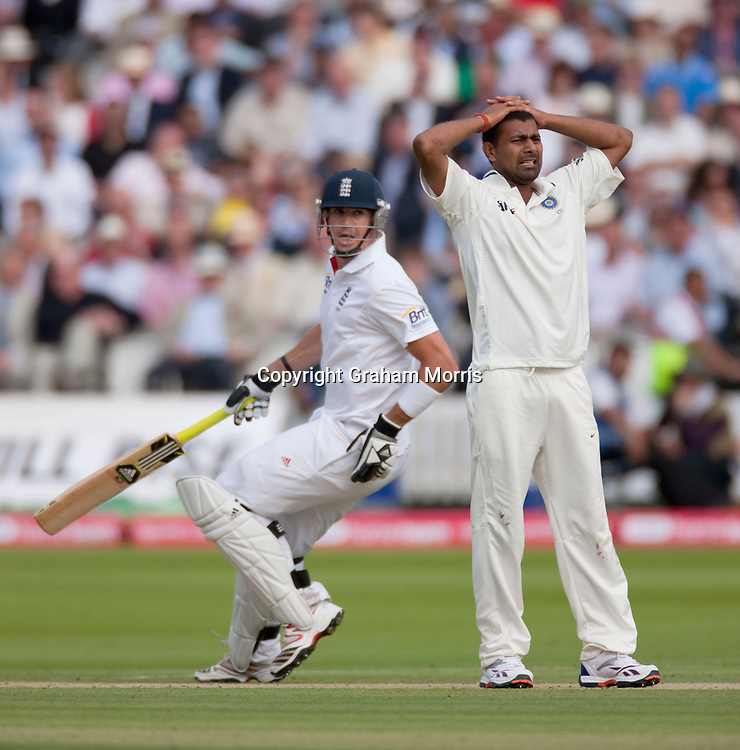 Bowler Praveen Kumar is frustrated by Kevin Pietersen (left) during the first npower Test Match between England and India at Lord's Cricket Ground, London.  Photo: Graham Morris (Tel: +44(0)20 8969 4192 Email: sales@cricketpix.com) 22/07/11