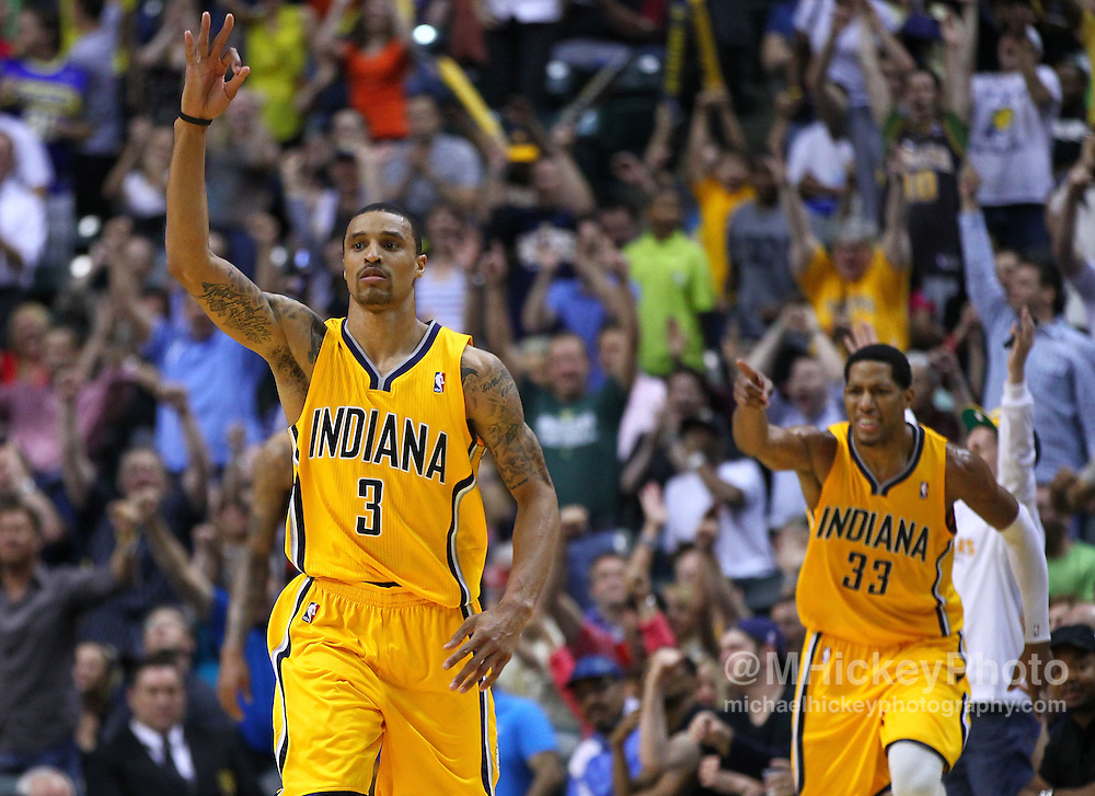 April 03, 2012; Indianapolis, IN, USA; Indiana Pacers shooting guard George Hill (3) gestures after a three point basket against the New York Knicks at Bankers Life Fieldhouse. Indiana defeated New York 112-104. Mandatory credit: Michael Hickey-US PRESSWIRE