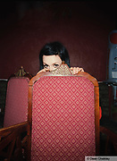 Harriet, hiding behind a chair, Southend, UK 2006