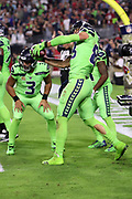 Seattle Seahawks tight end Jimmy Graham (88) mimes a baseball swing as if he were hitting one out of the park as he celebrates after catching a 6 yard touchdown pass good for a 7-0 first quarter Seahawks lead during the 2017 NFL week 10 regular season football game against the Arizona Cardinals, Thursday, Nov. 9, 2017 in Glendale, Ariz. The Seahawks won the game 22-16. (©Paul Anthony Spinelli)