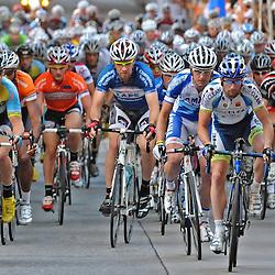 The beginning of the Iron Hill Twilight Criterium Pro Men's race heads down Gay Street. TK4