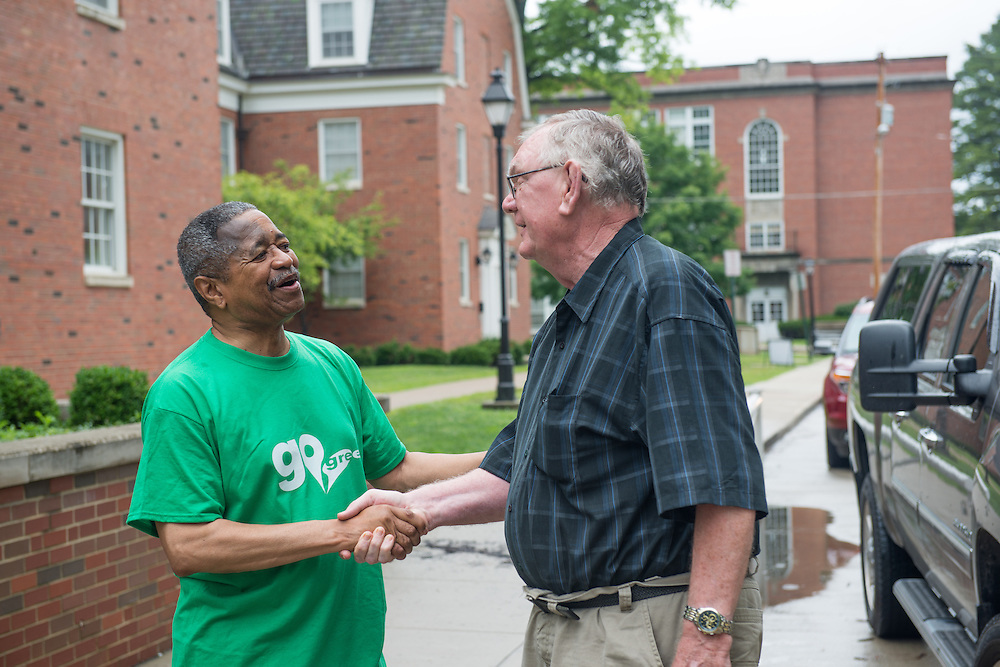 President Roderick McDavis greets Ted Coakley, a grandparent to first year student Maddie Climer, during move- in on East Green. Photo by Ben Siegel