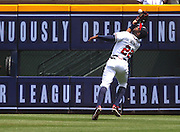 Right fielder Jason Heyward of the Atlanta Braves makes an over the shoulder catch during the game against the Kansas City Royals at Turner Field on April 17, 2013.