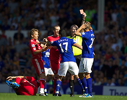 LIVERPOOL, ENGLAND - Saturday, October 1, 2011: Referee Martin Atkinson shows the red card to Everton's Jack Rodwell after a tackle on Liverpool's Luis Alberto Suarez Diaz during the Premiership match at Goodison Park. (Pic by Vegard Grott/Propaganda)