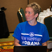A member of the NH delegation listens to Newark NH Mayor Cory Booker speaking at a NH Democratic Party Breakfast at the 2012 Democratic National Convention