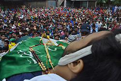 August 2, 2017 - Pulwama, Jammu and Kashmir, India - (EDITORS NOTE: Image depicts death) People surround near the dead body of Akeel Ahmed Bhat, a teenage boy, during his funeral procession in Haal village, about 47 Kilometers (29 miles) south of Srinagar, Indian controlled Kashmir, Wednesday, Aug. 2, 2017. A fresh strike called by anti-India separatists to protest the killings of two top rebels and a civilian shut down disputed Kashmir Wednesday while a teenage boy died a day after he was wounded by government forces. (Credit Image: © Muneeb Ul Islam/Pacific Press via ZUMA Wire)