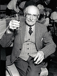 Portrait of an elderly man having a glass of wine at Christmas day centre meal, Nottingham, UK. December 1990