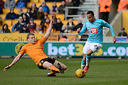 Wolverhampton Wanderers striker Bjorn Sigurdarson dives into tackle Derby County defender Marcus Olsson during the Sky Bet Championship match between Wolverhampton Wanderers and Derby County at Molineux, Wolverhampton, England on 27 February 2016. Photo by Alan Franklin.