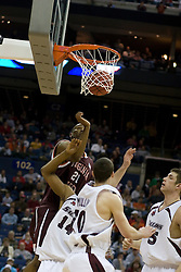 Virginia Tech Hokies forward Lewis Witcher (21) scores over Southern Illinois Salukis forward Randal Falker (14).  The #4 seed Southern Illinois Salukis defeated the #5 seed Virginia Tech Hokies 63-48 in the second round of the Men's NCAA Basketball Tournament at the Nationwide Arena in Columbus, OH on March 18, 2007.