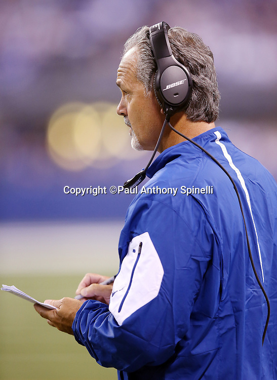 Indianapolis Colts head coach Chuck Pagano takes notes as he looks on from the sideline during the 2015 NFL week 2 regular season football game against the New York Jets on Monday, Sept. 21, 2015 in Indianapolis. The Jets won the game 20-7. (©Paul Anthony Spinelli)