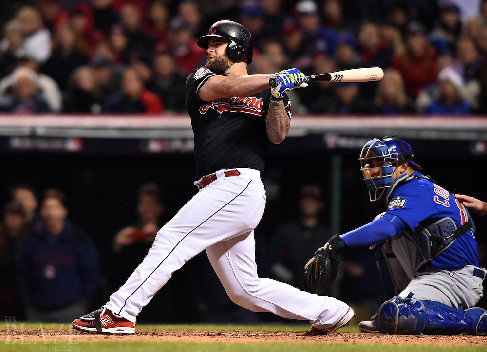 Oct 26, 2016; Cleveland, OH, USA; Cleveland Indians first baseman Mike Napoli hits a single against the Chicago Cubs in the 6th inning in game two of the 2016 World Series at Progressive Field. Mandatory Credit: Ken Blaze-USA TODAY Sports