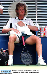 Wayne Ferreira holds an ice pack on his injured thigh