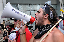 Black Bloc Protestors march through the streets against the Westboro Baptist Church during the Republican National Convention, Tuesday, August 28, 2012 in Tampa, FL. Hundreds of protestors from  marched through the streets of Tampa. (AP Photo/Chris Post)