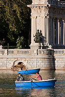 people relaxing on the boating lake in parque del retiro in madrid, spain