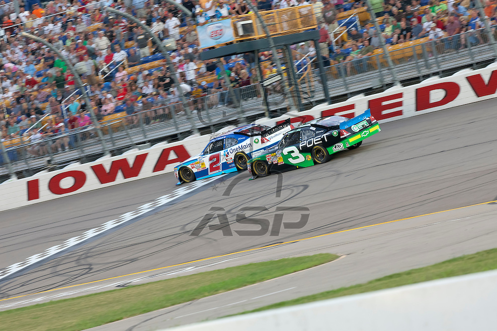 NEWTON, IA - AUG 04, 2012:  Elliot Sadler (2) and Austin Dillan (3) bring their cars through the turns during the U.S. Cellular 250 Sprint Cup Series race at the Iowa Speedway in Newton, IA.