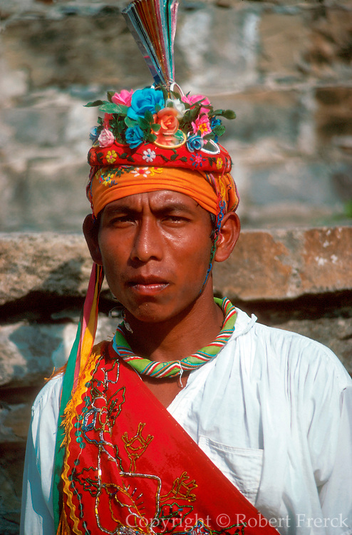 MEXICO, PEOPLE, VILLAGES Voladore dancer, portrait of Mayan Indian in dance costume, at El Tajin in the State of Veracruz