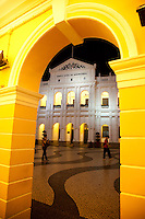 The beautiful old Holy House of Mercy sits on Senado Square in  historic Macau through an archway.
