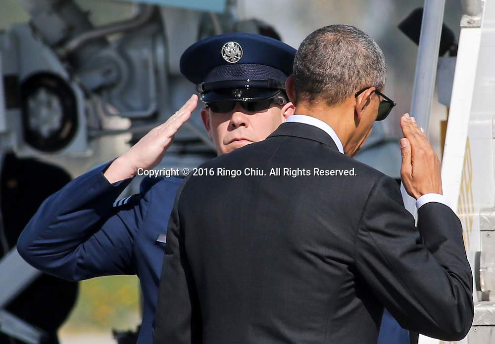 President Barack Obama, right, salutes as he boards Air Force One at Los Angeles International Airport in Los Angeles, Friday, Feb 12, 2016, en route to Palm Springs in advance of a summit of Asian leaders on Monday and Tuesday, which the president will host at Sunnylands resort in Rancho Mirage. Obama will be joined by Secretary of State John Kerry at Sunnylands for the gathering of leaders from the Association of Southeast Asian Nations. The summit is aimed at strengthening the new U.S.-ASEAN strategic partnership, forged last November during a presidential trip to Malaysia. (Photo by Ringo Chiu/PHOTOFORMULA.com)<br /> <br /> Usage Notes: This content is intended for editorial use only. For other uses, additional clearances may be required.