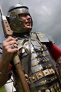 Re-enactment soldier at Housesteads Fort on Roman Hadrian's Wall, once the northern frontier of Rome's empire.