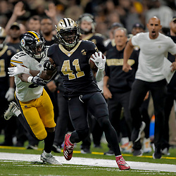 Dec 23, 2018; New Orleans, LA, USA; New Orleans Saints running back Alvin Kamara (41) runs past Pittsburgh Steelers safety Marcus Allen (27) during the second quarter at the Mercedes-Benz Superdome. Mandatory Credit: Derick E. Hingle-USA TODAY Sports