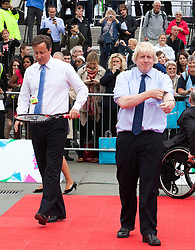 **FILE PICTURE- David Cameron and Boris Johnson will will campaign against each other ahead of an EU Referendum on June 23rd, 2016** © Licensed to London News Pictures. 08/09/2011. London, UK. Prime Minister David Cameron and London Mayor Boris Johnson getting ready for Tennis Match. International Paralympic Day is held in London's Trafalgar Square on the eve of tickets for the Paralympic Games going on sale. Photo credit: Bettina Strenske/LNP