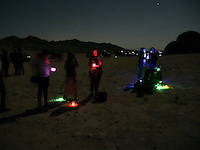 """High Desert Test Sites 2013. People waiting for the show """"Sighting"""" by Pascual Sisto and Joey Jensen to start at Giant Rock in Landers, CA."""
