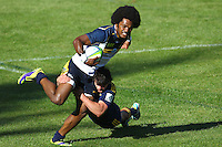 QUEENSTOWN, NEW ZEALAND - JANUARY 31:  Henry Speight of the Brumbies is tackled during the Super Rugby trial match between the Highlanders and the Brumbies on January 31, 2014 in Queenstown, New Zealand.  (Photo by Teaukura Moetaua/Getty Images)